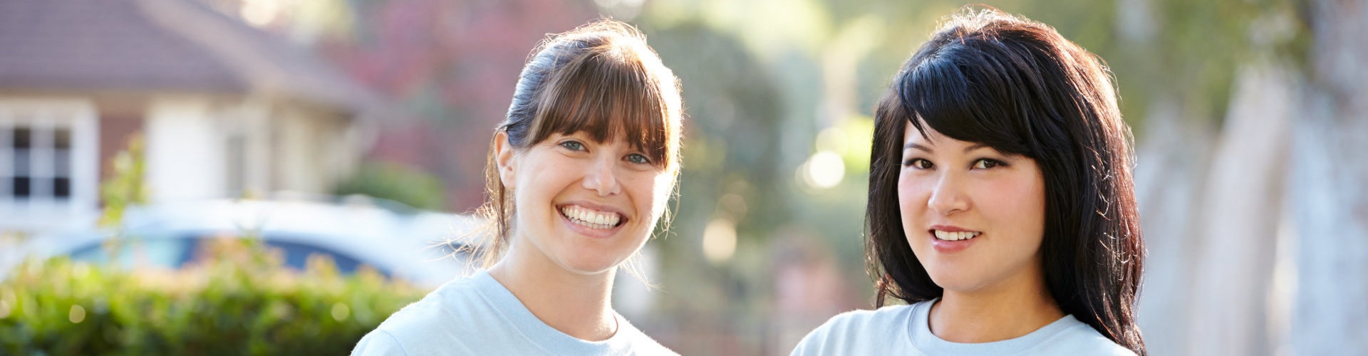 two volunteers smiling