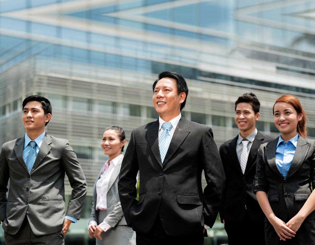 businessmen and women smiling