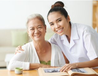 senior woman and young woman smiling